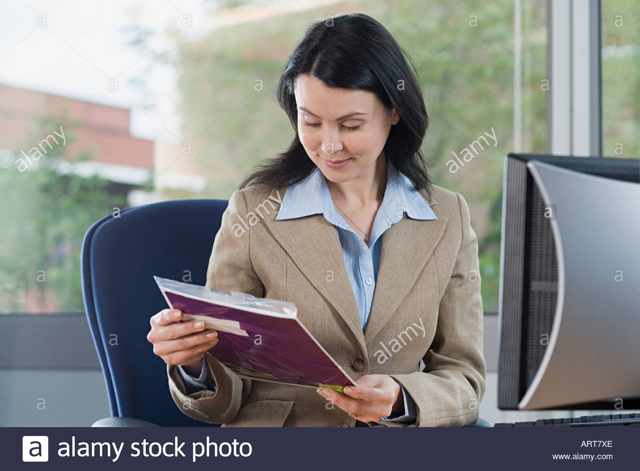 Businesswoman looking at post - Stock Image