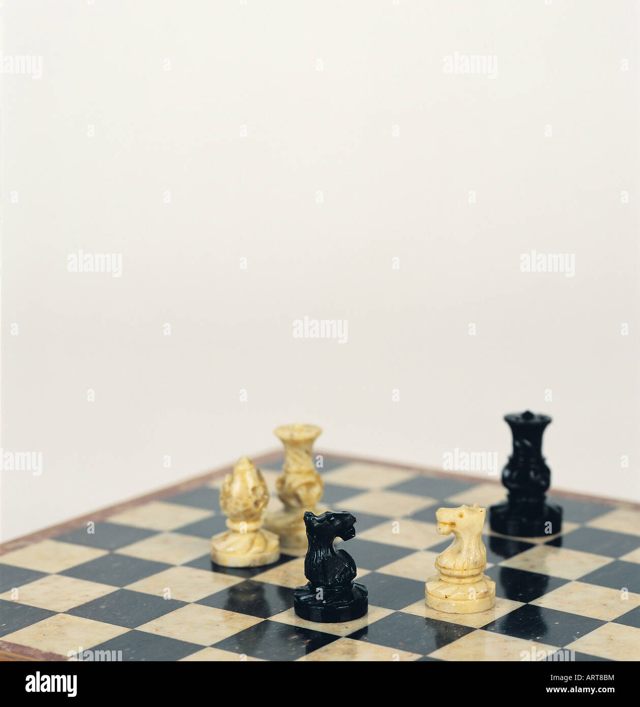 Chess pieces on a chess board - Stock Image