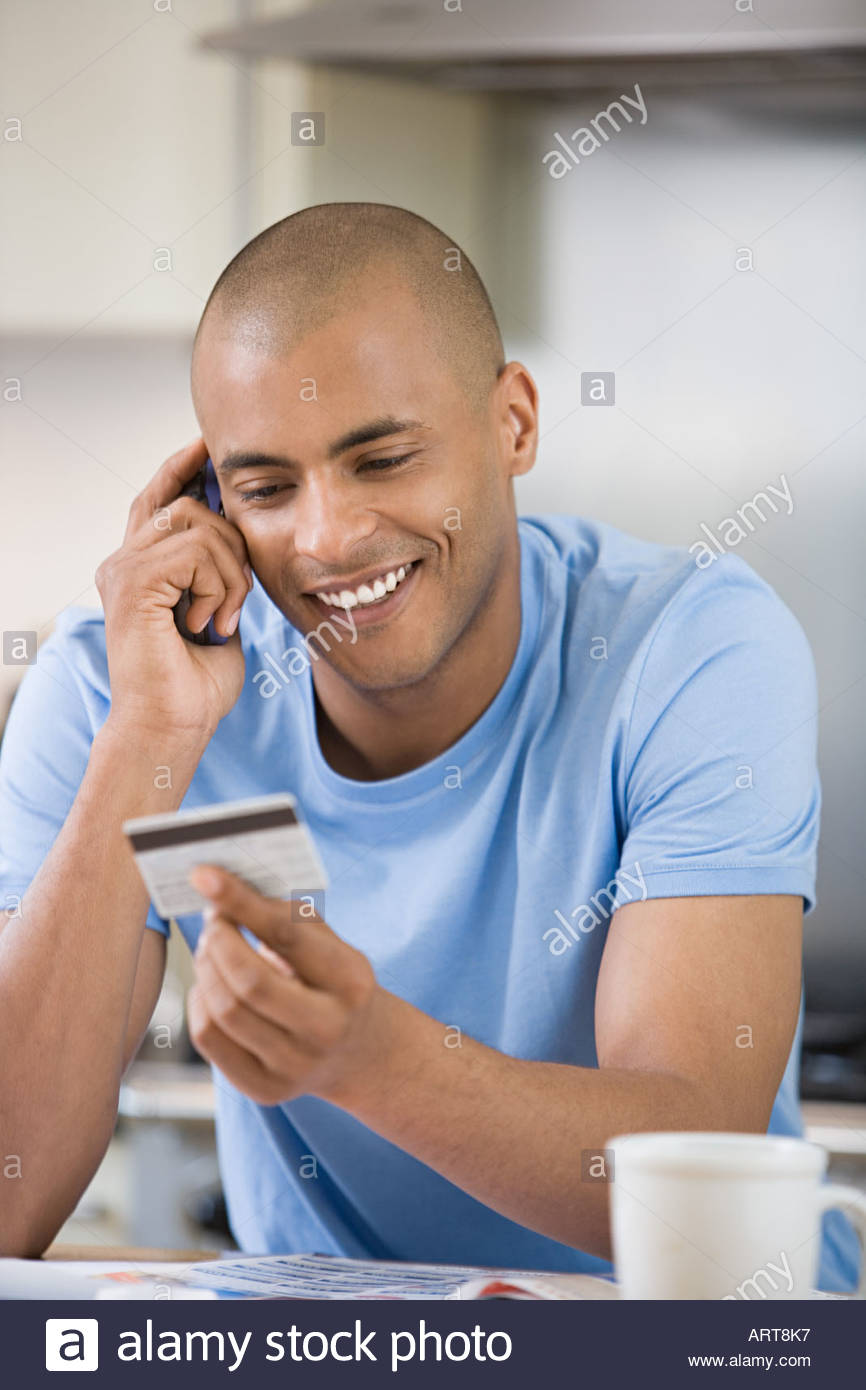 Man shopping over the telephone - Stock Image