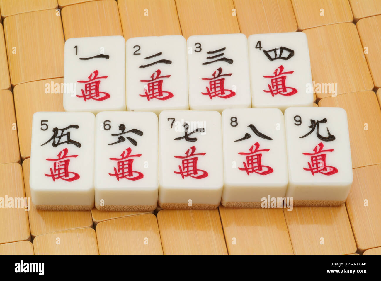 Mah Jongg tiles pieces  numbers 1 2 3 4 5 6 7 8 9 one two three four five six seven eight nine Stock Photo