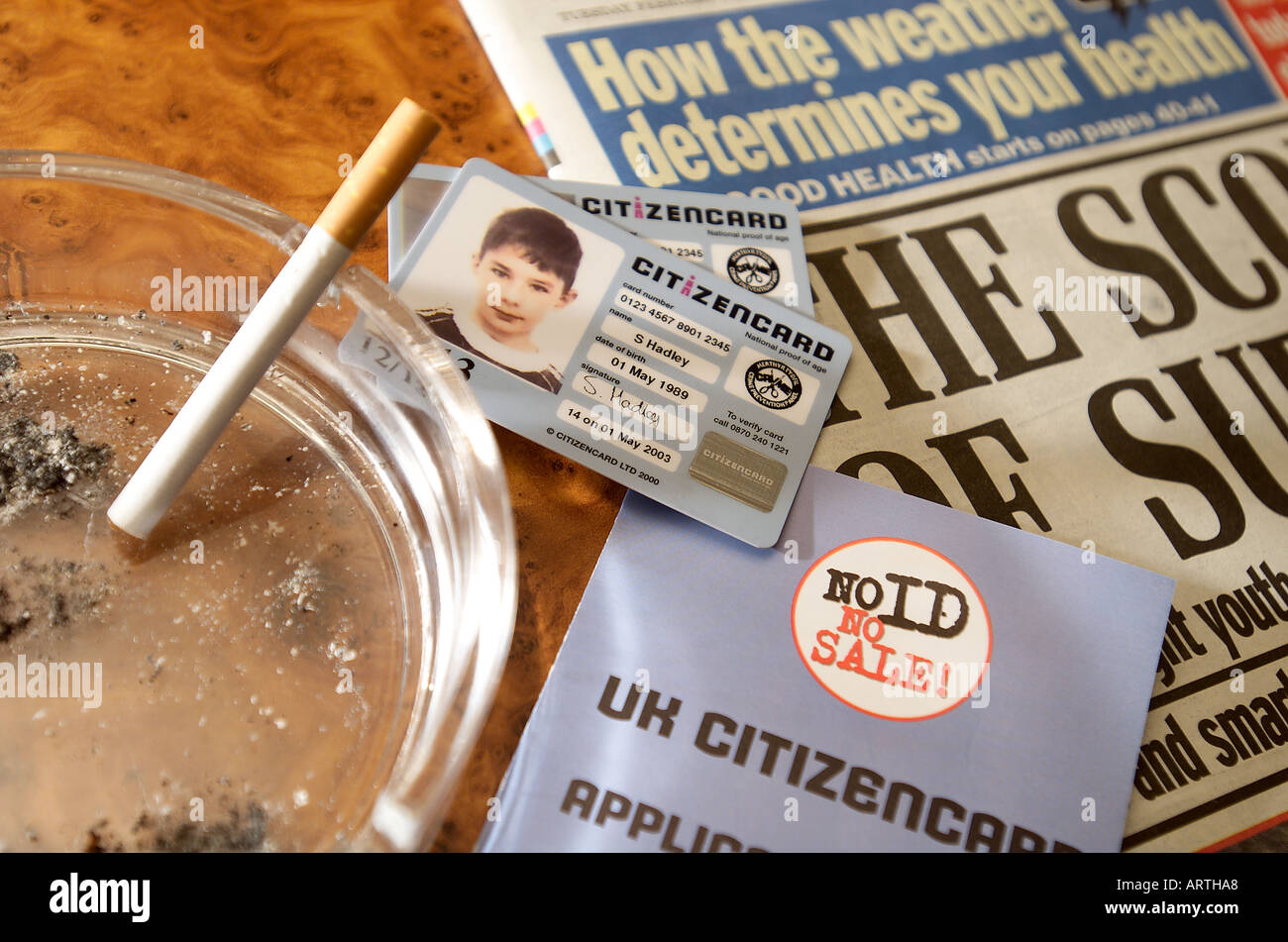 British (Welsh) Young Persons Identity card with lit cigarette. - Stock Image