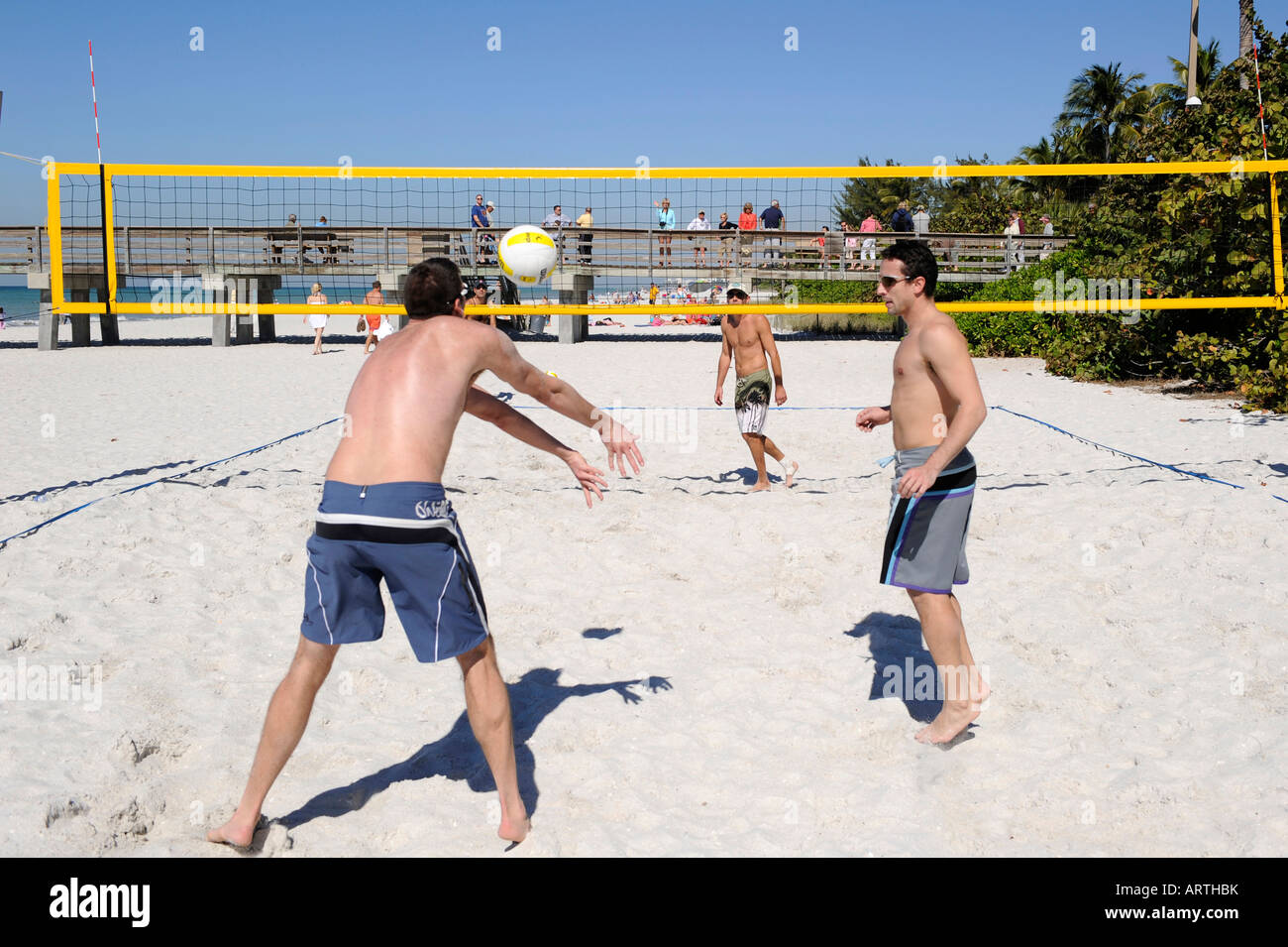 Beach 2 on 2 volleyball played at The Pier Beach Naples Florida - Stock Image