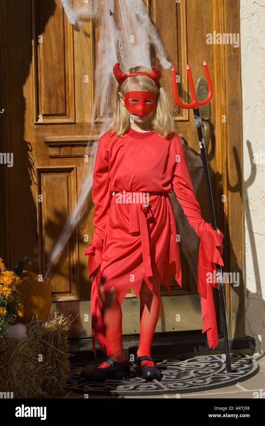 Child in a devil costume for Halloween - Stock Image