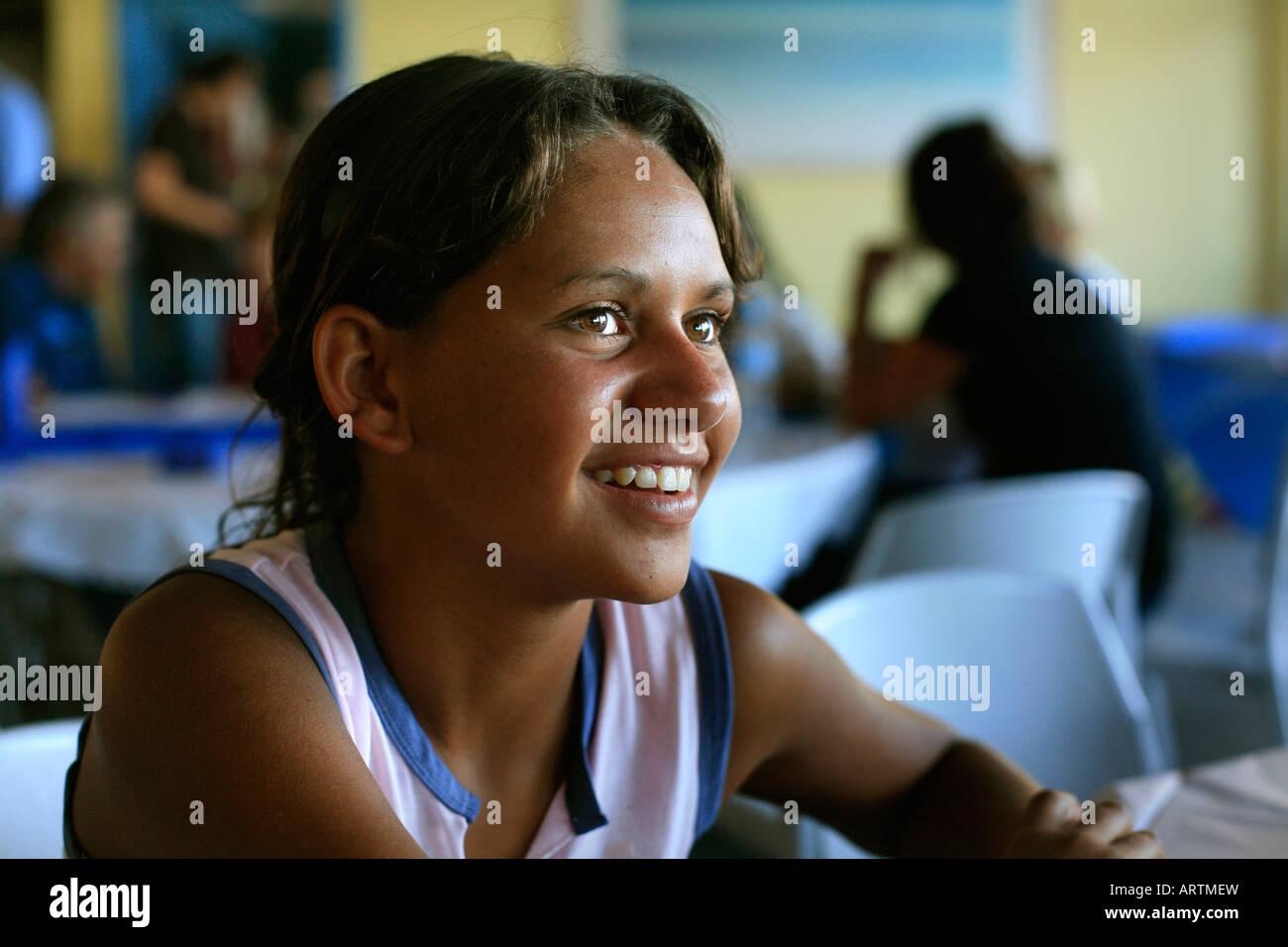 Smiling Australian aboriginal schoolgirl - Stock Image