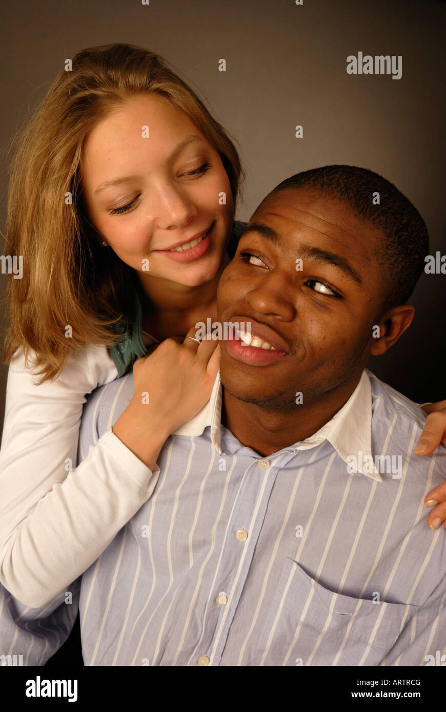 Happy young mixed rade couple. - Stock Image