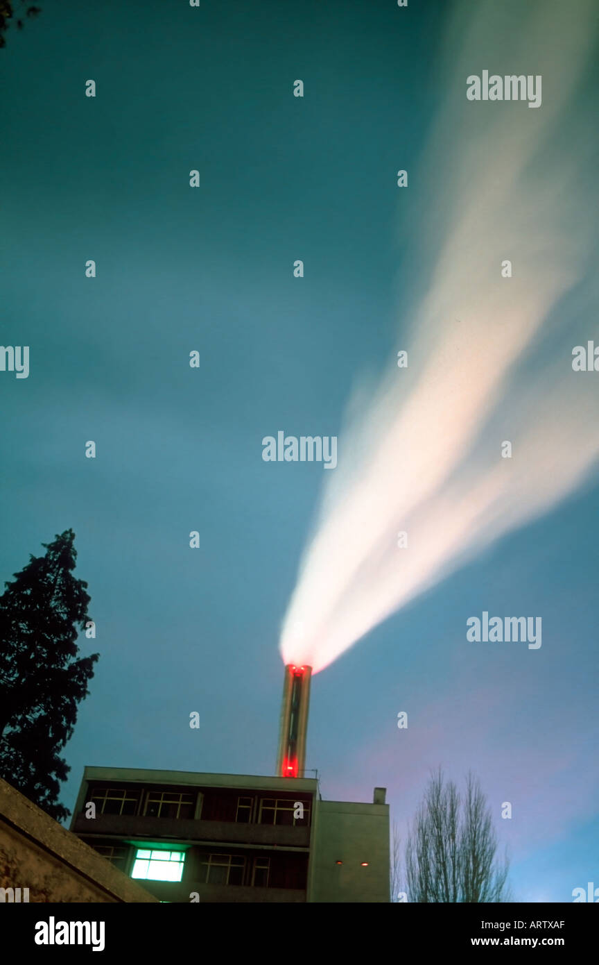 Air Pollution France Sky Smoke from Garbage Incinerator, At Dusk Power Generation - Stock Image