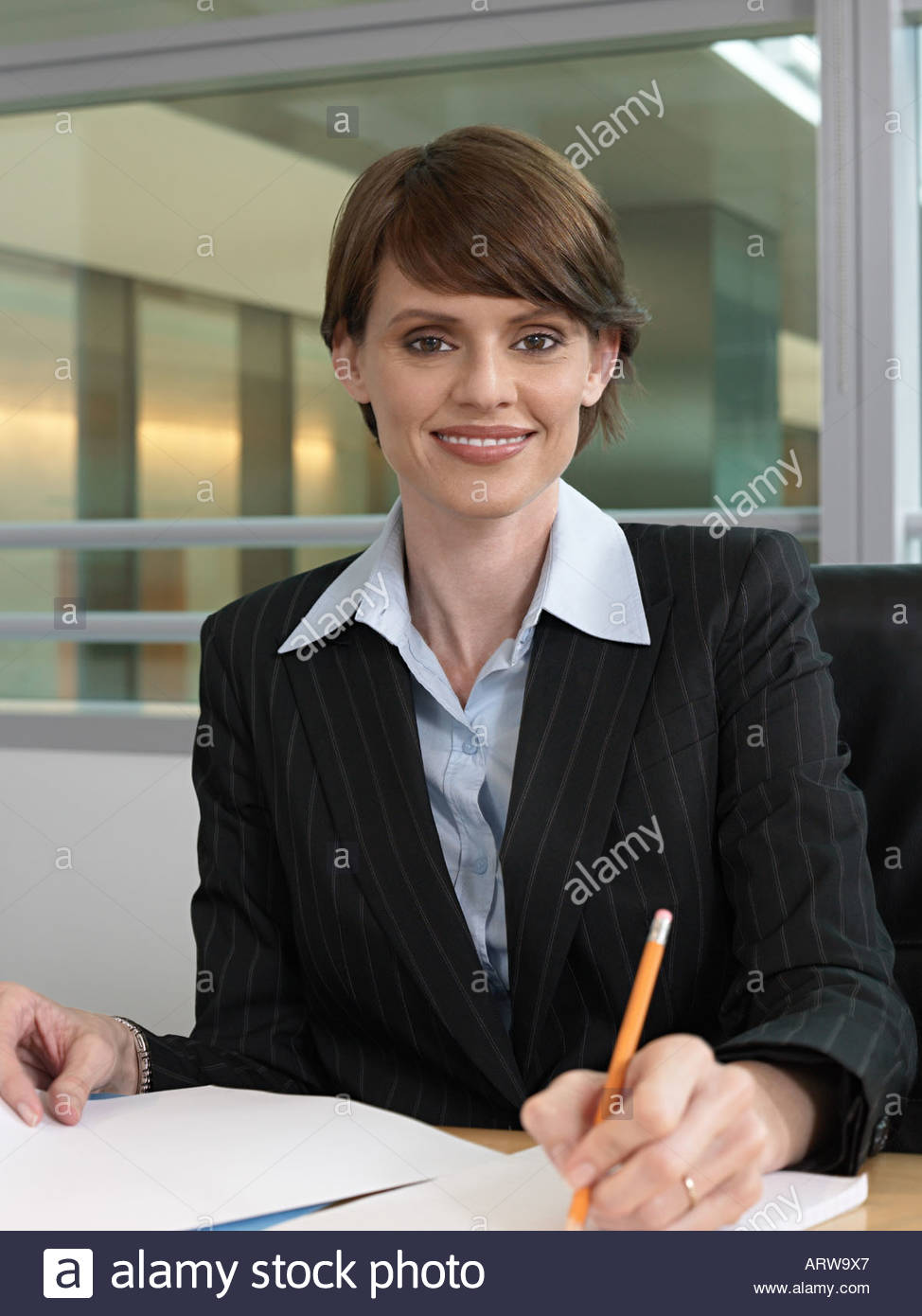 Businesswoman making notes - Stock Image