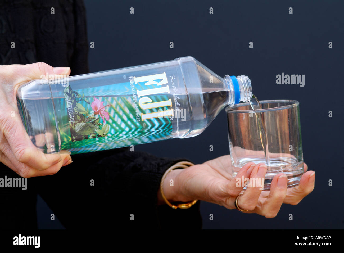 Fiji Bottled Water Being Poured Into A Glass Expensive