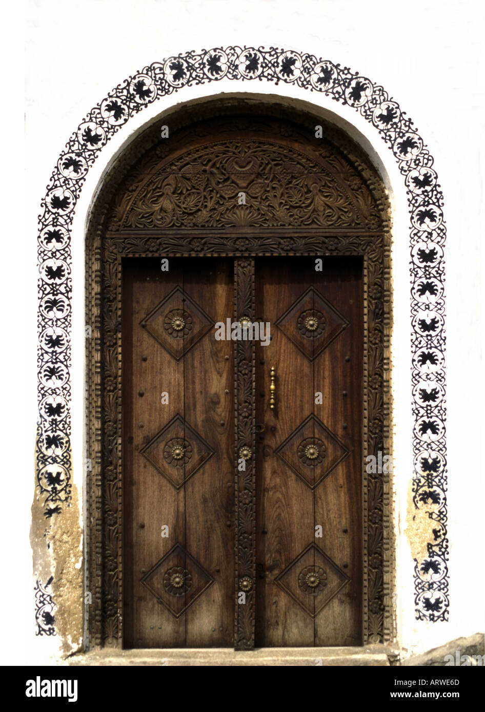 Typical traditional wooden carved door in the stone town of Zanzibar Tanzania East Africa Stock Photo
