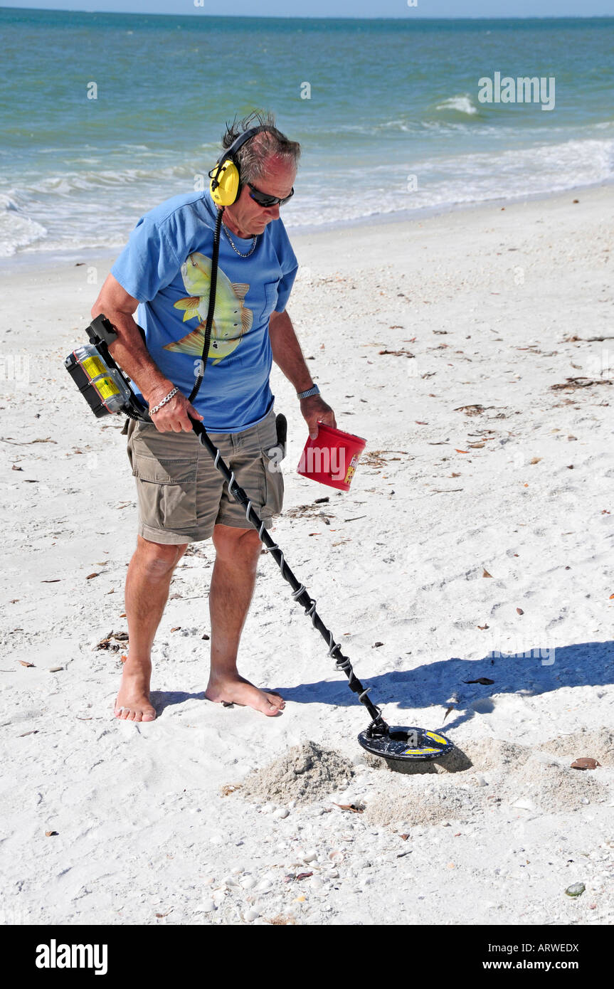 Jew Detector: Senior Male Uses Metal Detector To Find Objects On A Beach