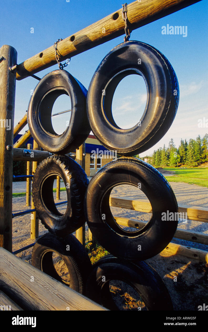 Car tires in a children's playground - Stock Image