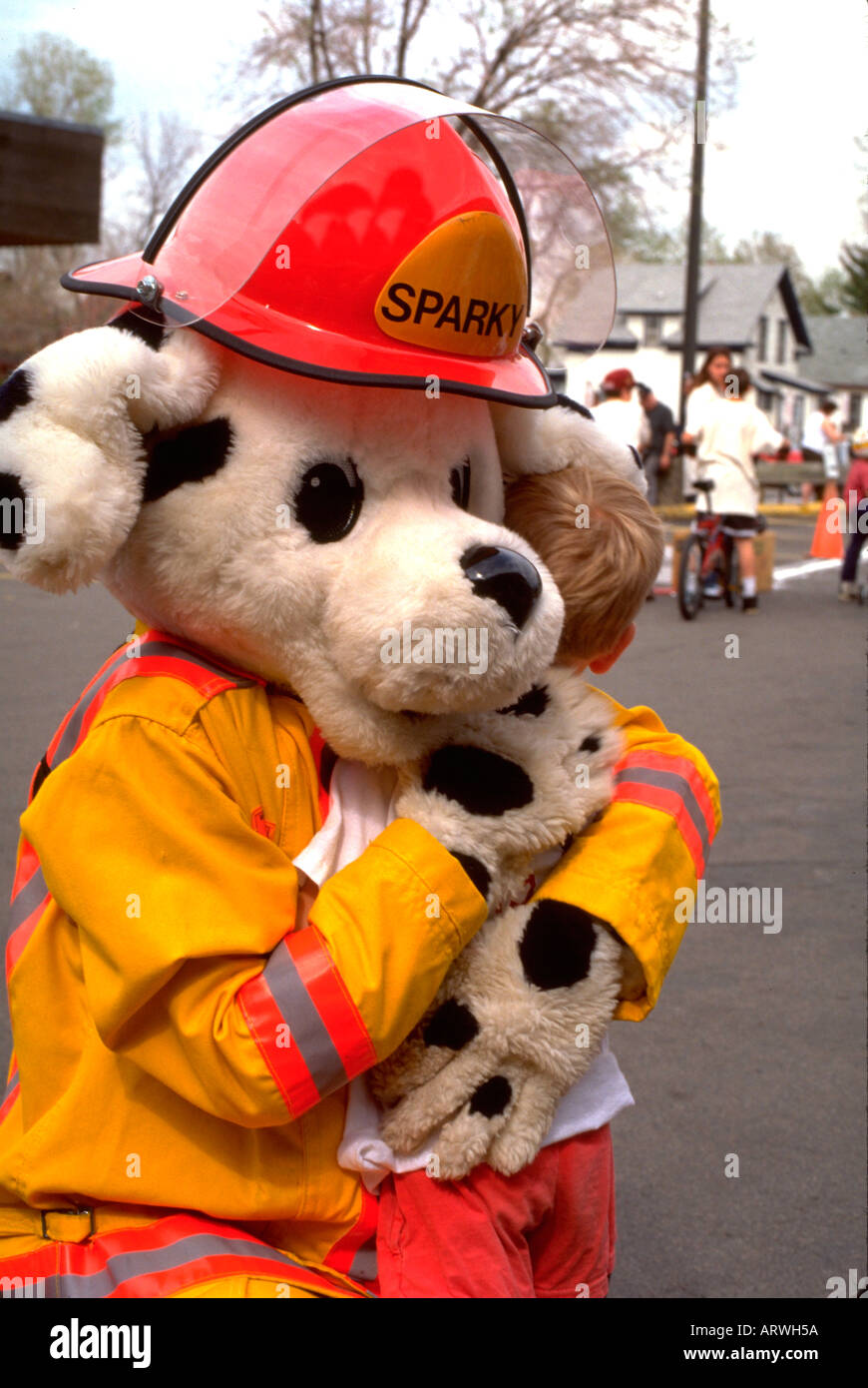 Sparky The Fire Department Mascot Hugging Boy Age 35 And 5 St Paul Minnesota USA