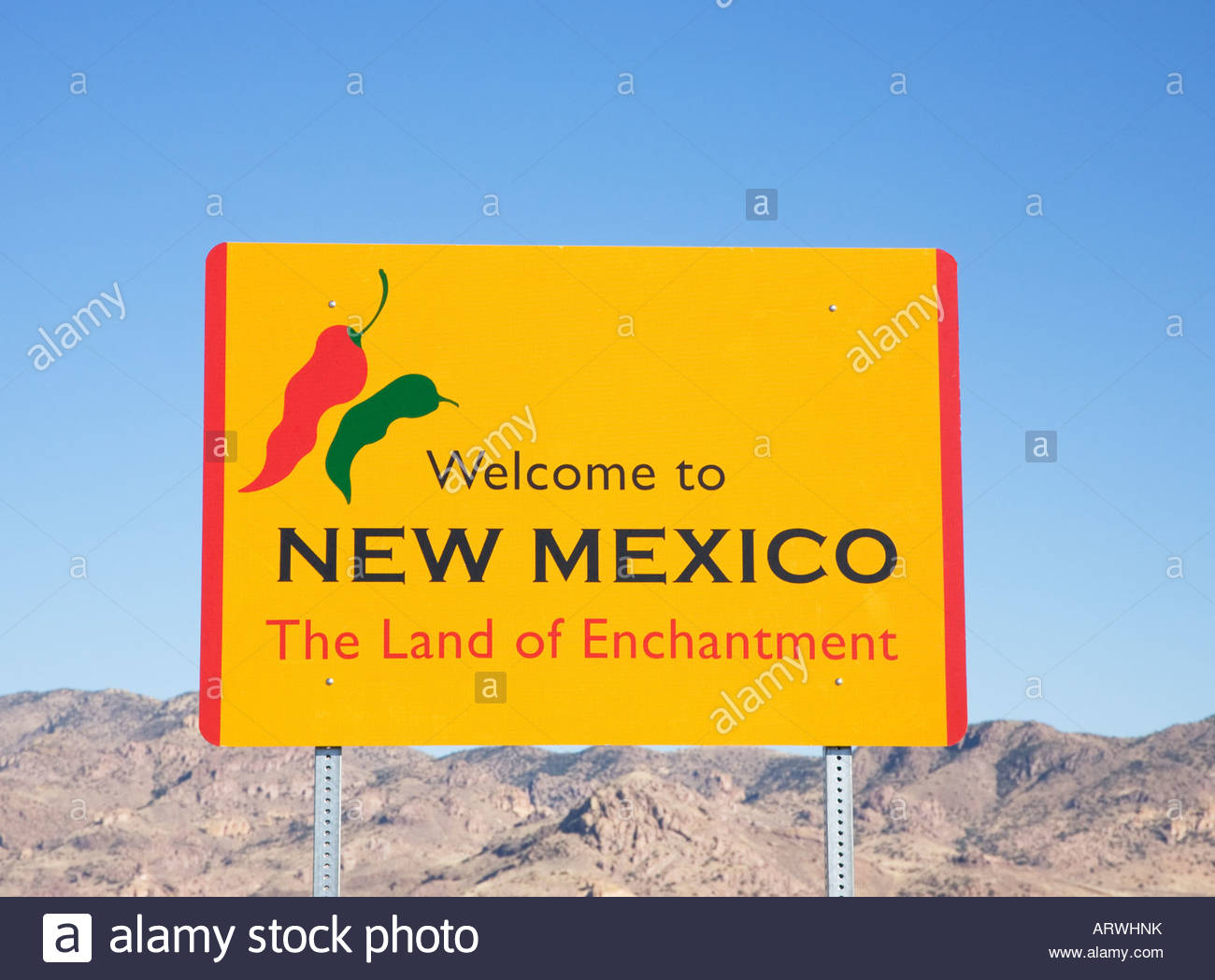 Highway sign Welcome to New Mexico The Land of Enchantment Portal Road Hidalgo County Chili peppers - Stock Image