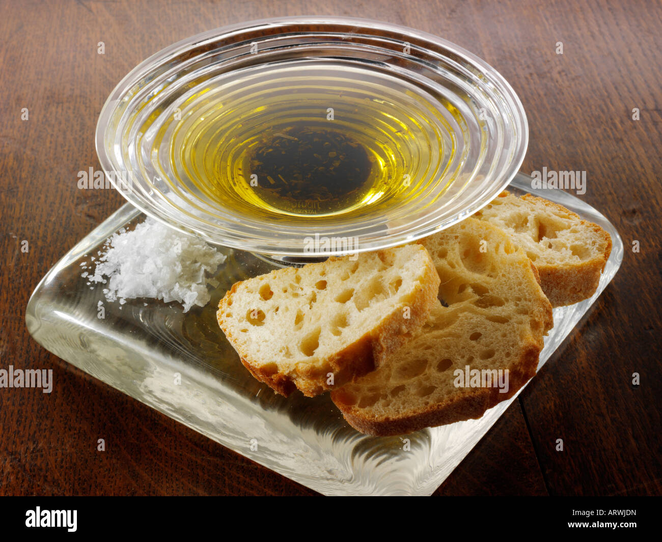 Bread and olive oil dipping sauce - Stock Image