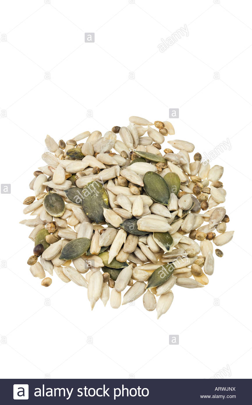 Mixed seeds. Mixture of sunflower seeds, pumpkin seeds and hemp seeds. Stock Photo