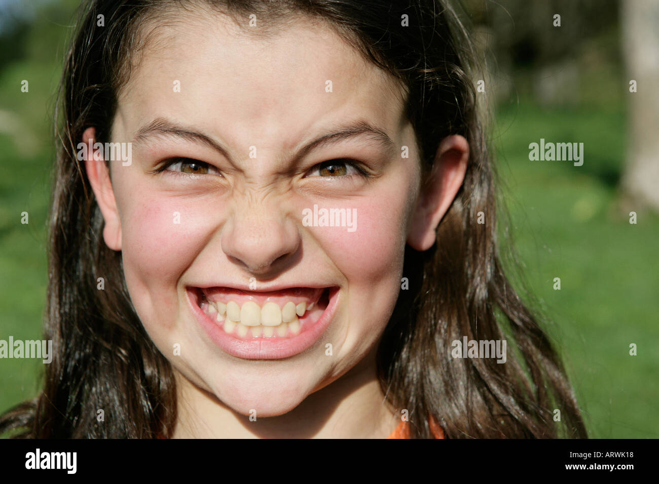 young brunette girl grinning ARWK18