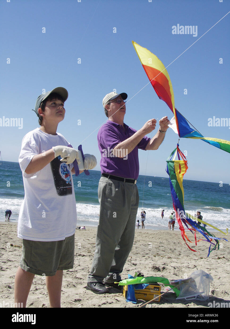 Father and son fly kites on Redondo Beach, CA. USA - Stock Image