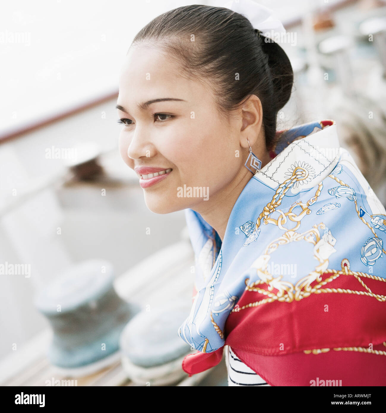 Side profile of a young woman smiling Stock Photo