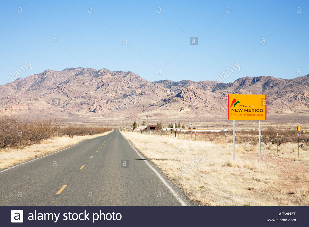 Highway sign Welcome to New Mexico Portal Road Hidalgo County Chili peppers Stock Photo