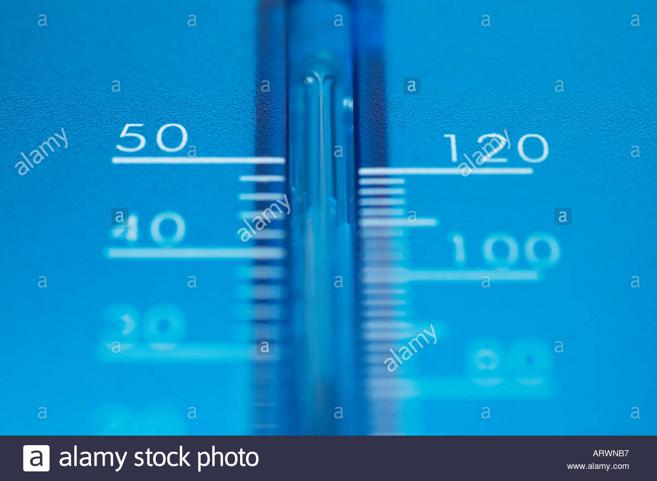 A clear blue thermometer - Stock Image