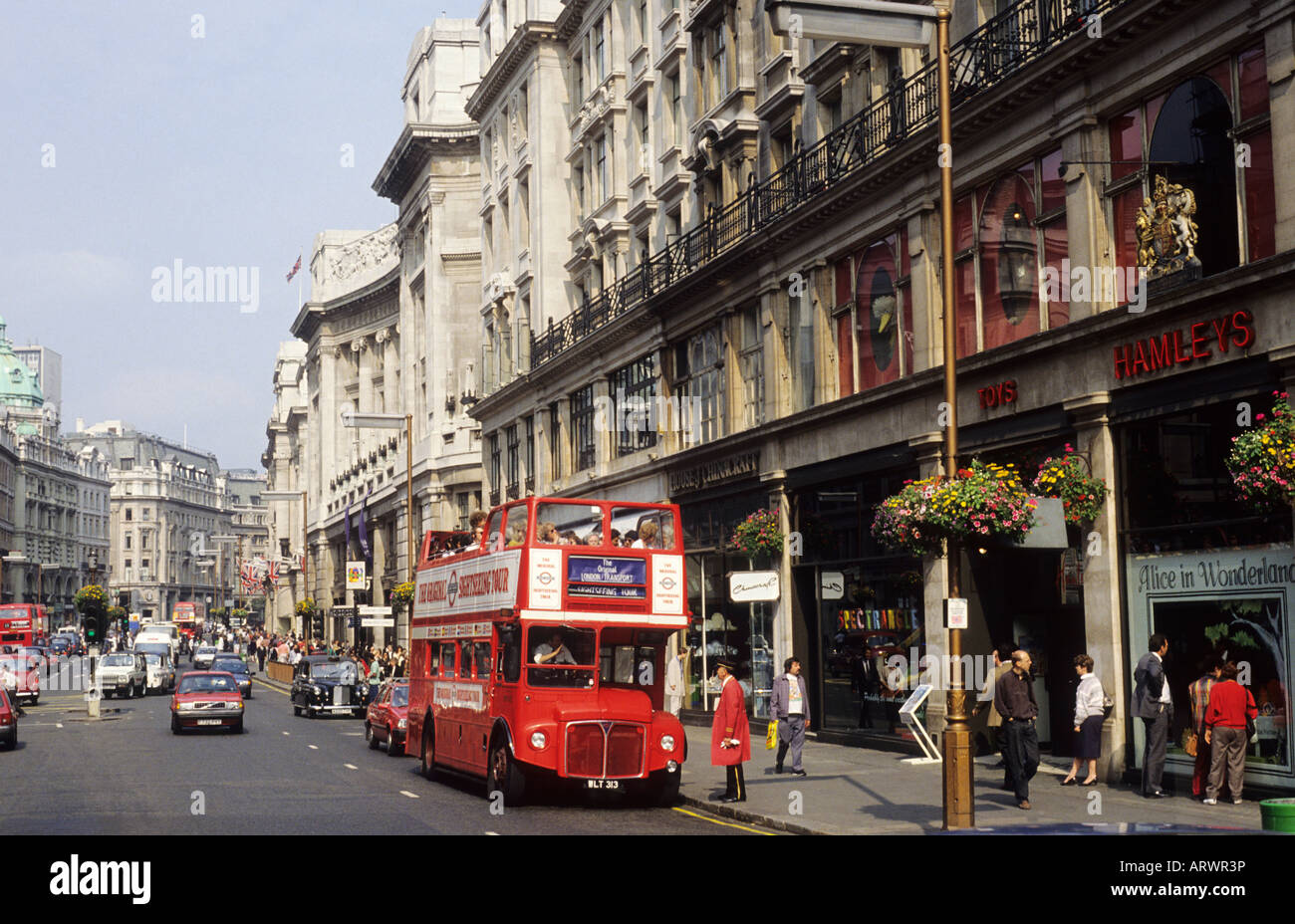 Regent Street London Hamleys Sightseeing red bus toy store shop shoppers shopping West End England UK - Stock Image