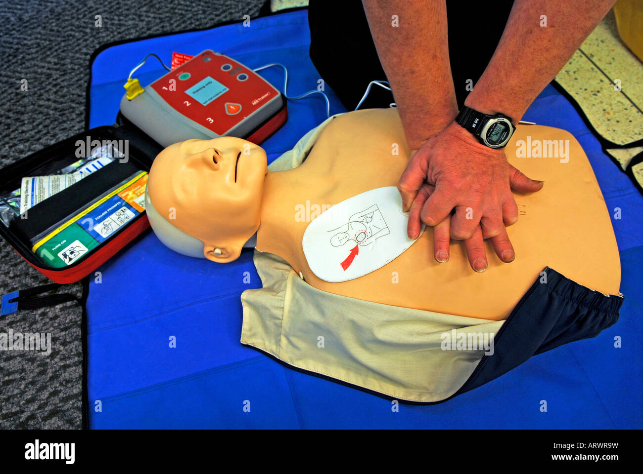 First Responder demonstrating resuscitation technique A voluntary service from St John Ambulance Service - Stock Image