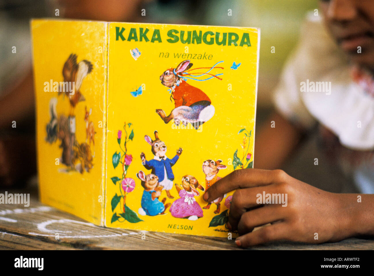 In Kenya a children's book in Swahili is about a baby rabbit - Stock Image