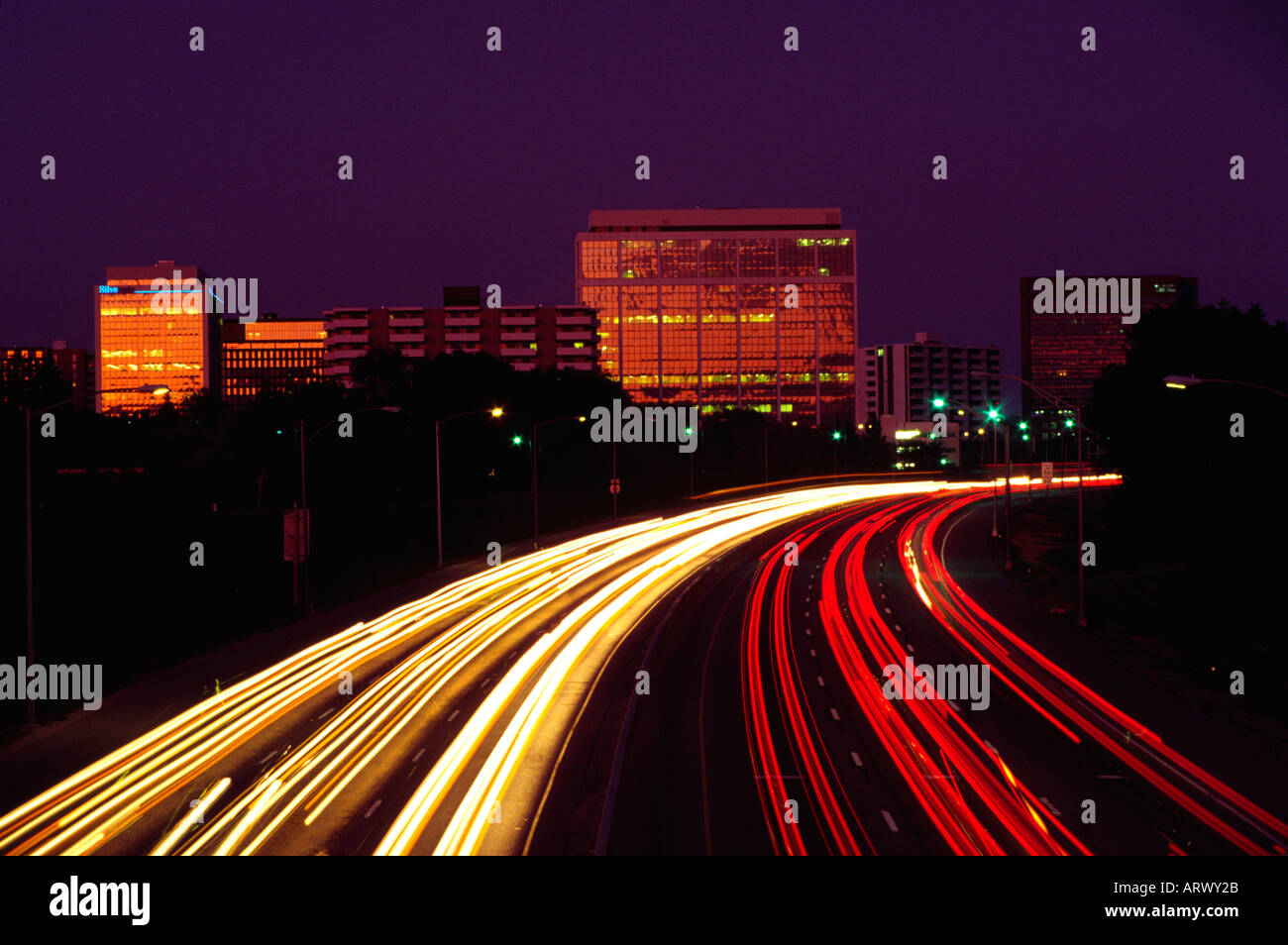 Time exposure of automobile traffic on Interstate 25 at Franklin Street in Denver Colorado at night - Stock Image