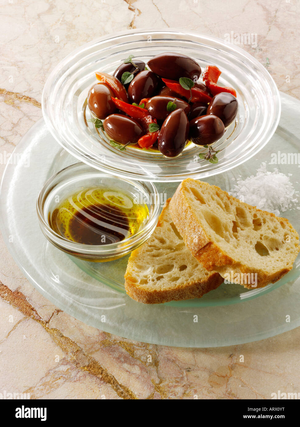 Olives with bread and olive oil dip - Stock Image