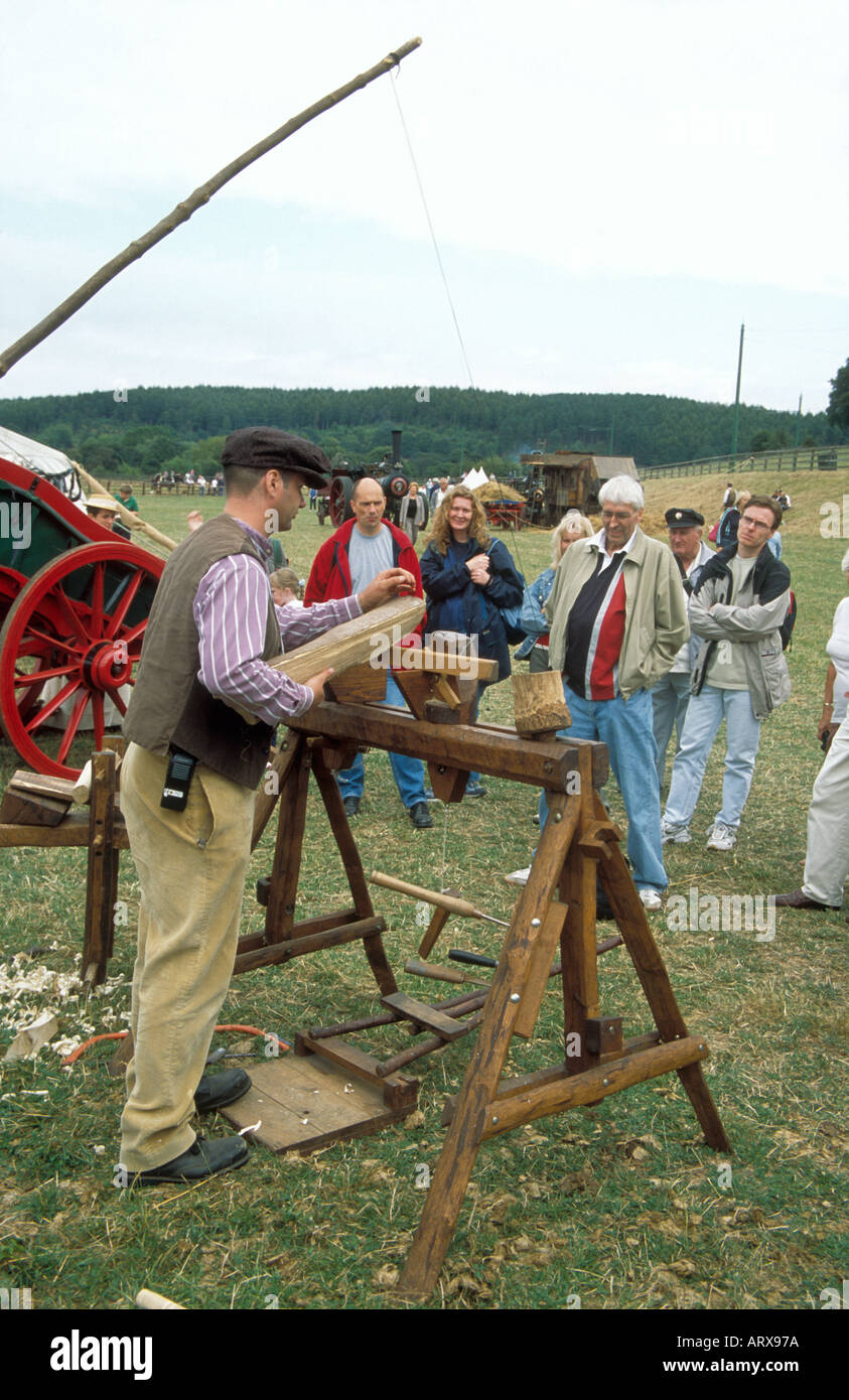 A craftsman using traditional pole lathe in a display of wood-turning Craft Fair at Beamish Open Air Museum at Chester le Street - Stock Image