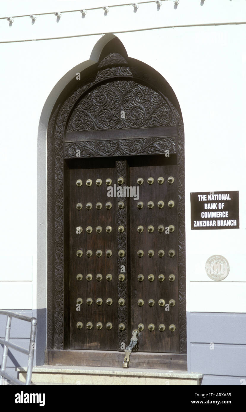 Typical traditional wooden carved door in the stone town of Zanzibar Tanzania East Africa - Stock Image