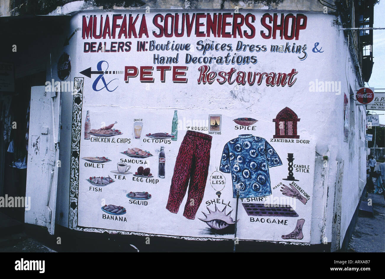 A colourful sign painted on a shop wall in the stone town Zanzibar Tanzania East Africa - Stock Image