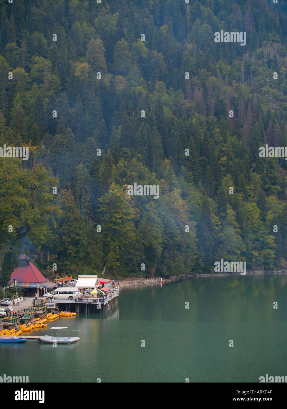 Populous embankment on a Ritsa Lake in Caucasian Mountains in Abkhazia - Stock Image