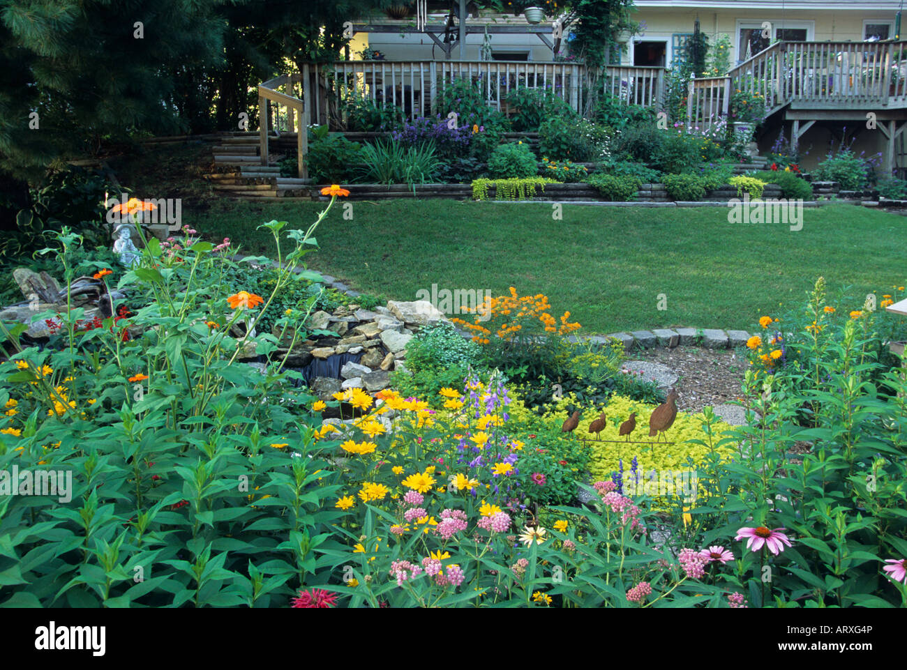 View Of Midwestern U S Garden In July With Terraced Flower Beds