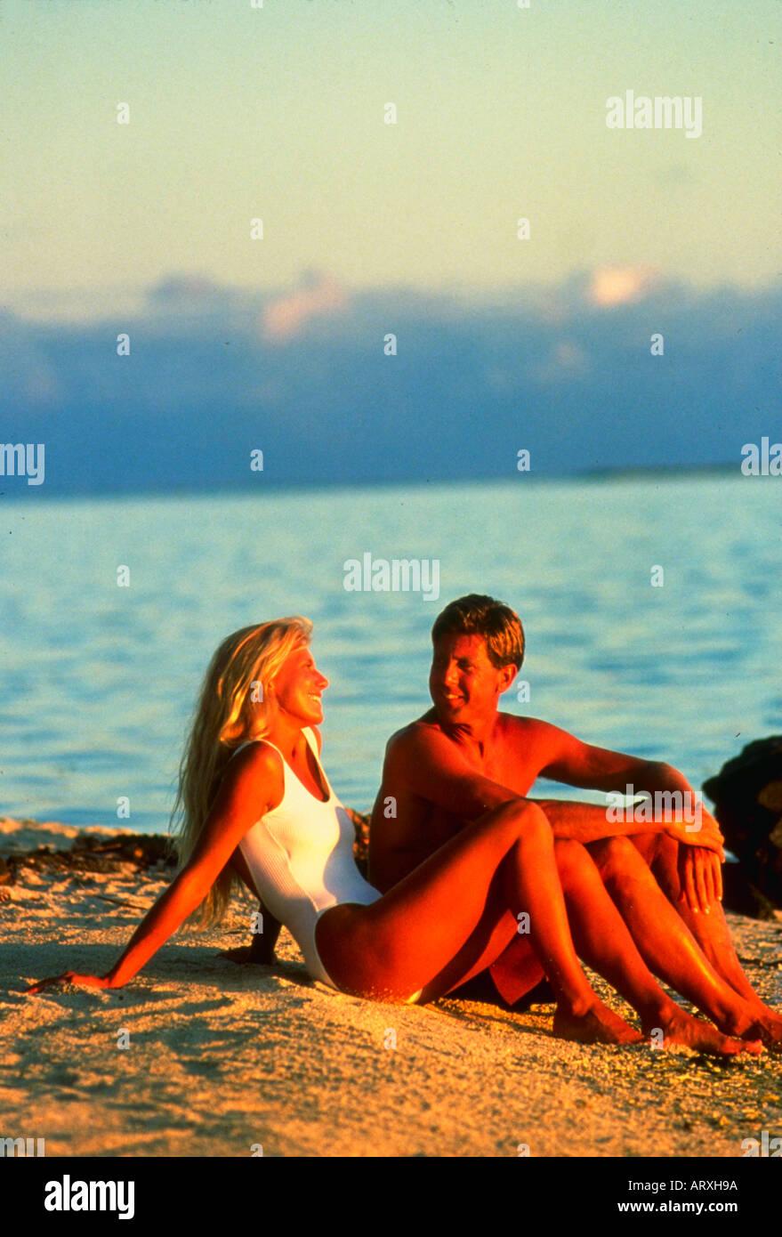 On Matira Beach at sunset on Bora Bora - Stock Image