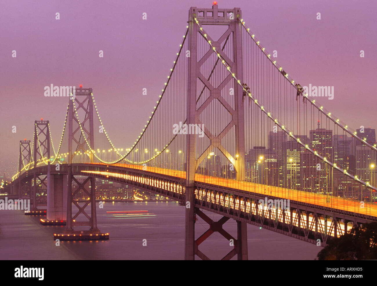 skyline at duskTraffic crossing Oakland Bay Bridge with San Francisco - Stock Image