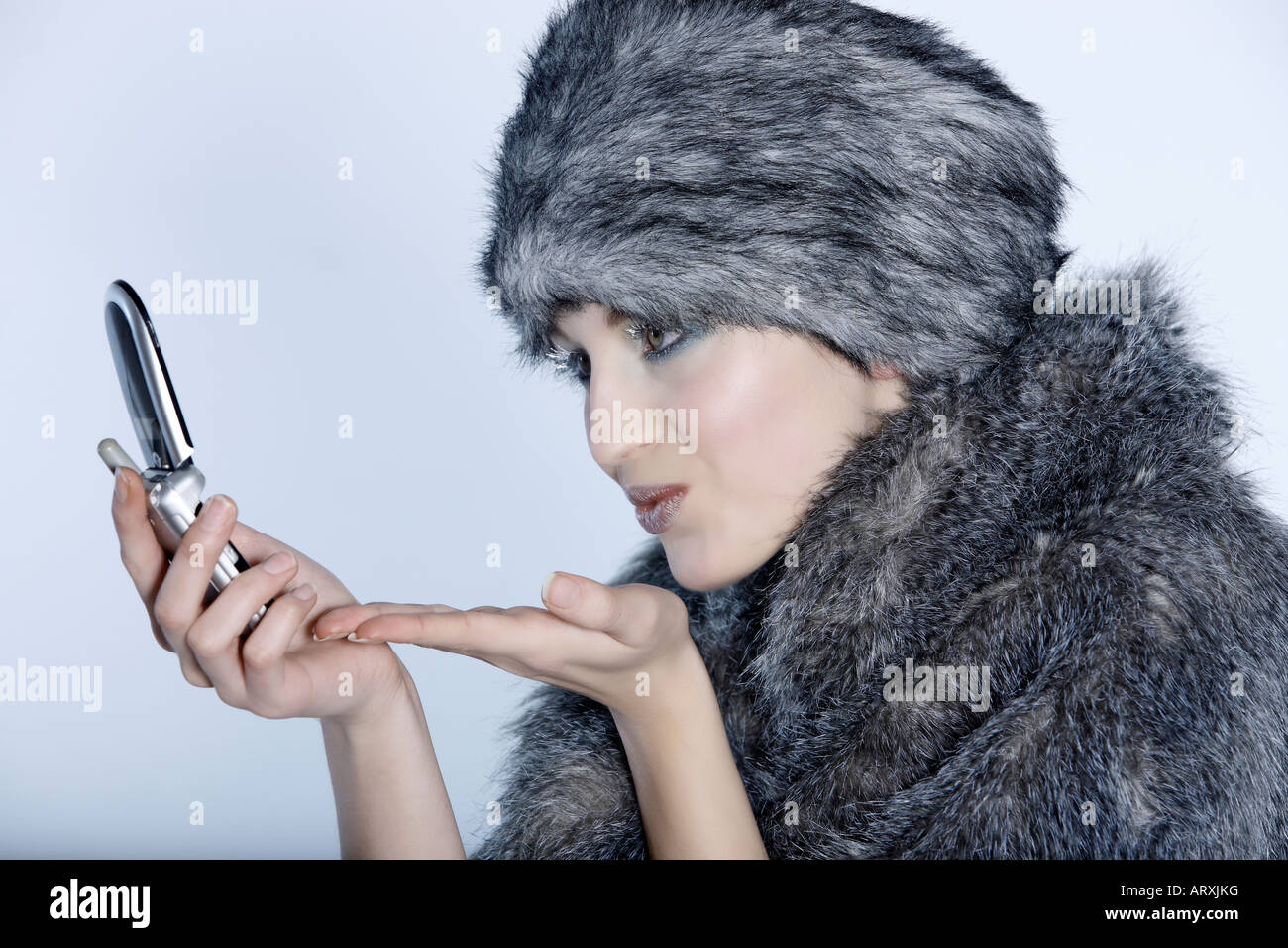 fcac82c6c4b studio shot portrait of a beautiful woman russian type in a fur coat and hat  kissing