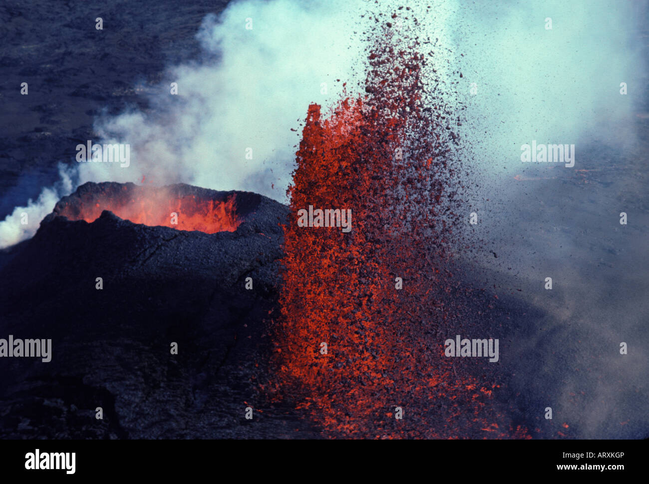 Kilauea Volcano erupting with fountaining lava and steam. Hawaii Volcanoes National Park, Puu Oo vent - Stock Image