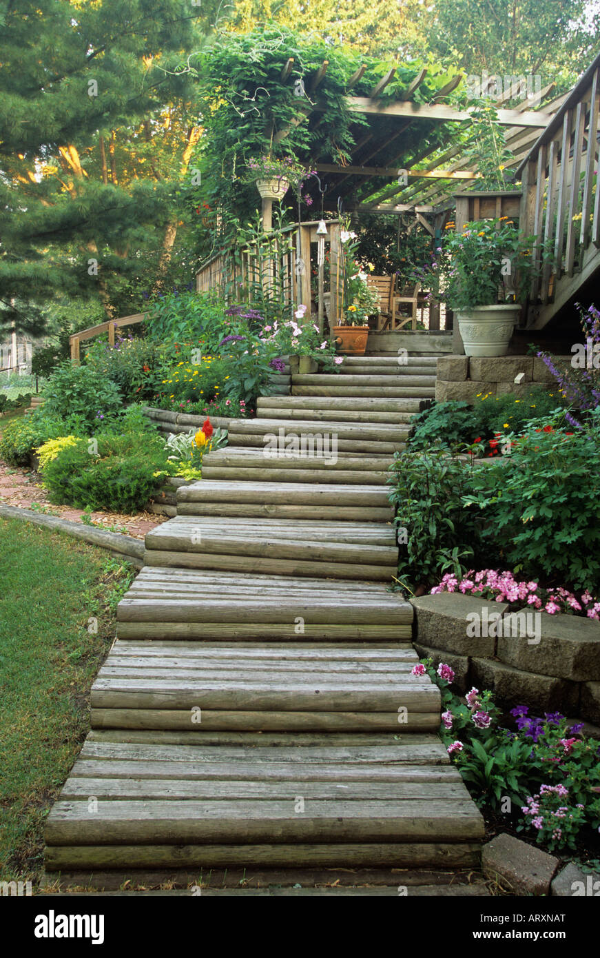 Steps Through Terraced Flower Beds Lead To Lower And Upper Decks