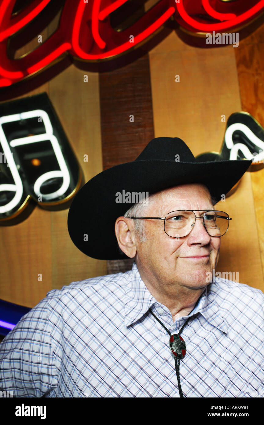 Senior Citizen with Bolo Tie and Cowboy Hat at Country Bar - Stock Image