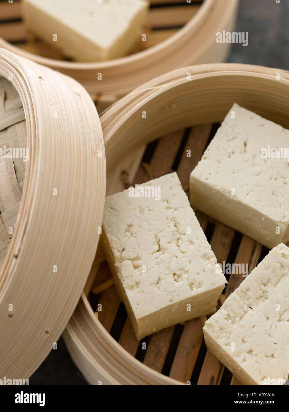 Tofu in bamboo steamer - Stock Image