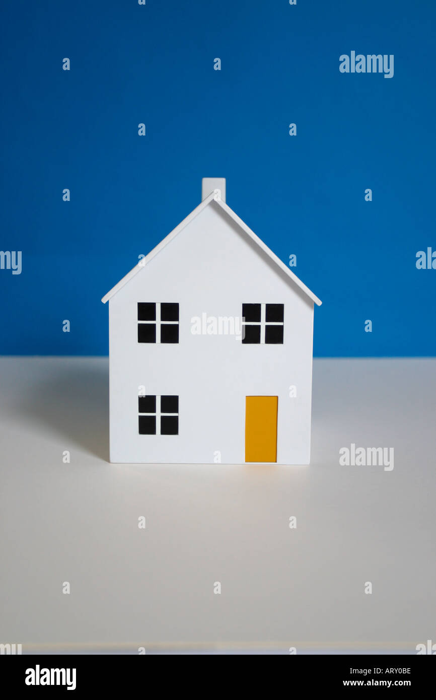 Model house with a blue background - Stock Image