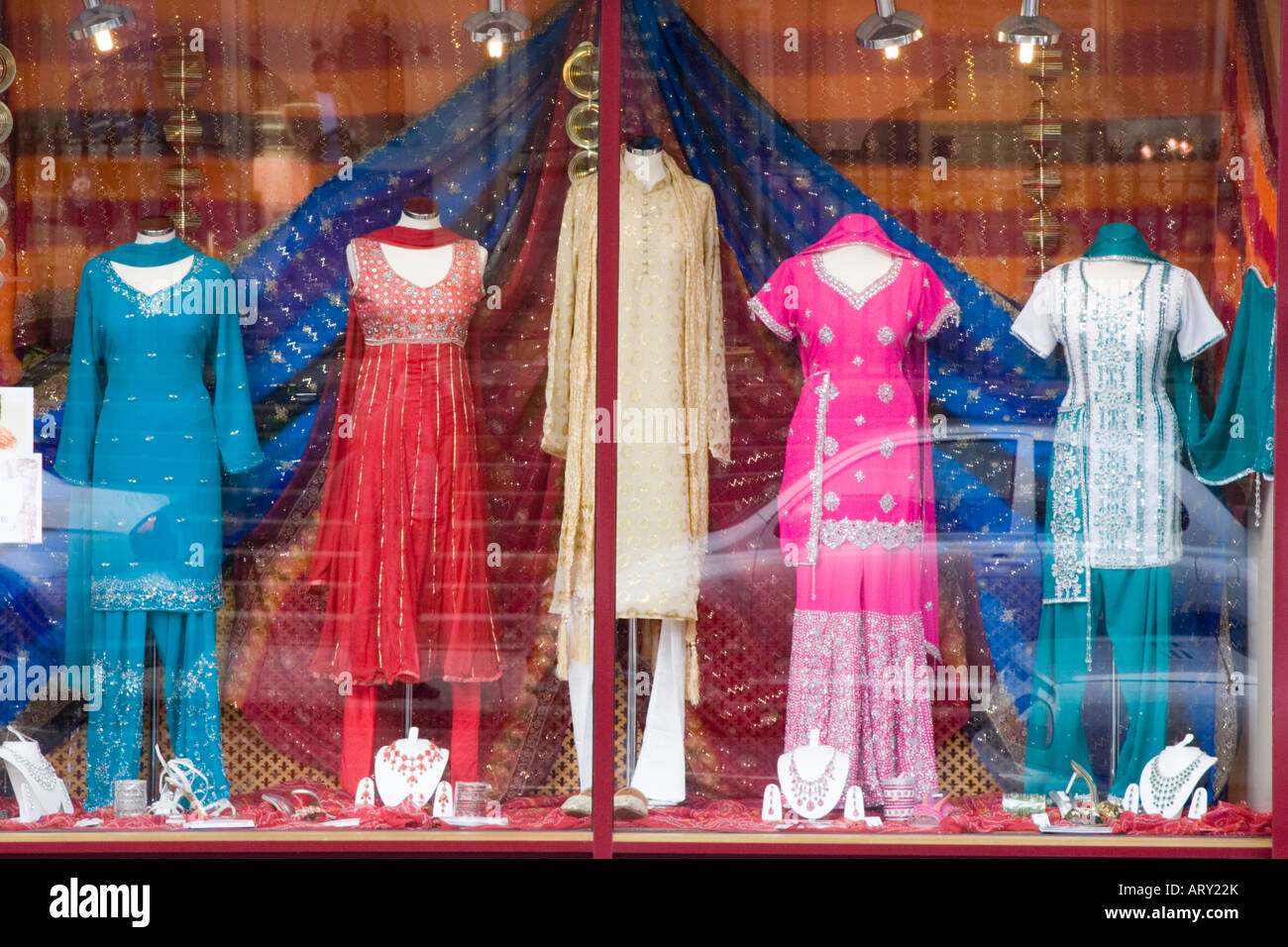 8ee352bb2f Indian clothes for sale in a shop window display Stock Photo ...