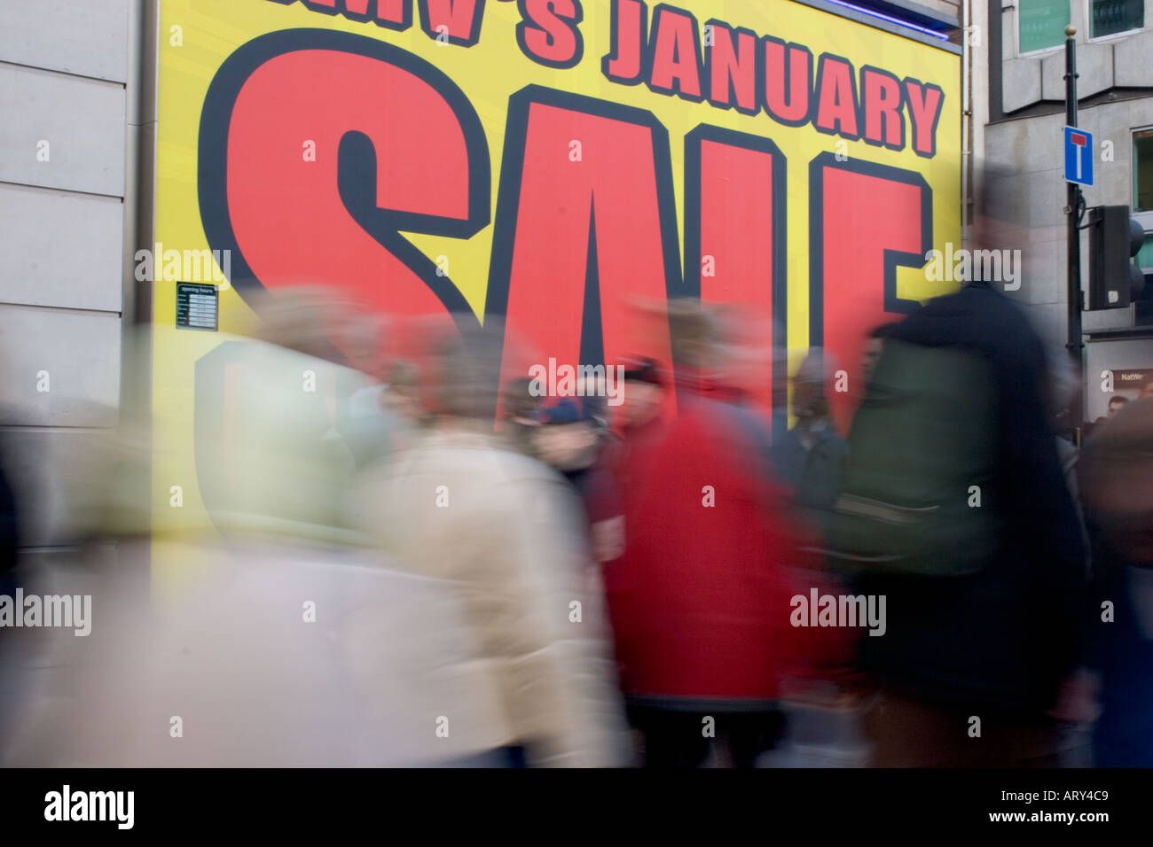 Bargain hunters shoppers walk past Sale signage in Oxford Street at  beginning of January Sales - e27f2d41b