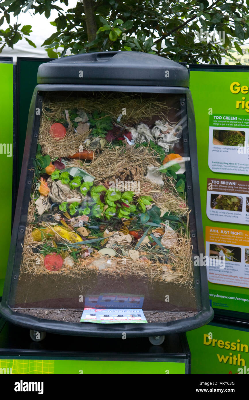 Cutaway compost bin to show section through rotting food waste inside Stock Photo