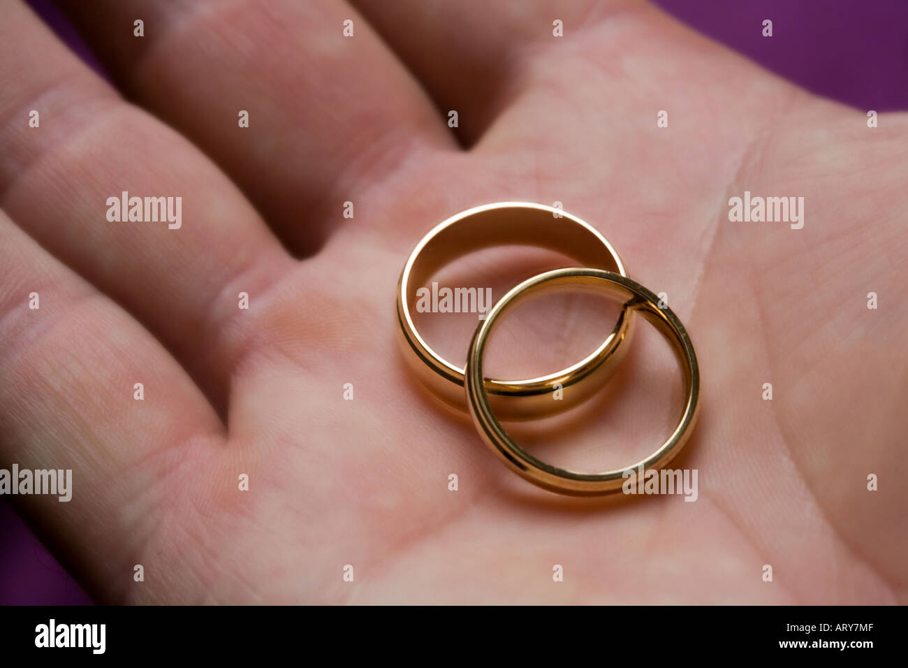 His and Her Wedding rings in palm of hand Stock Photo: 9228430 - Alamy