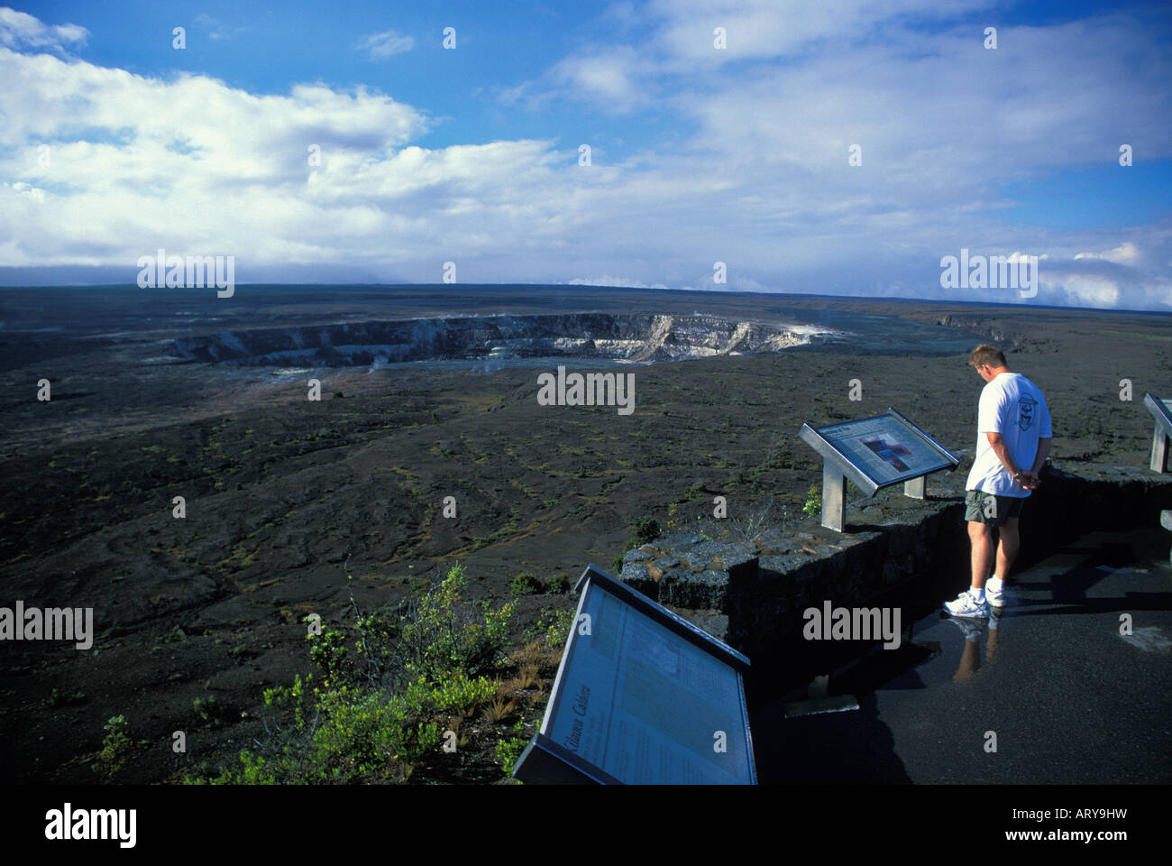 Man views the Kilauea Caldera from the Jagger Museum obseration area located on Crater Rim Drive, Volcanoes National - Stock Image