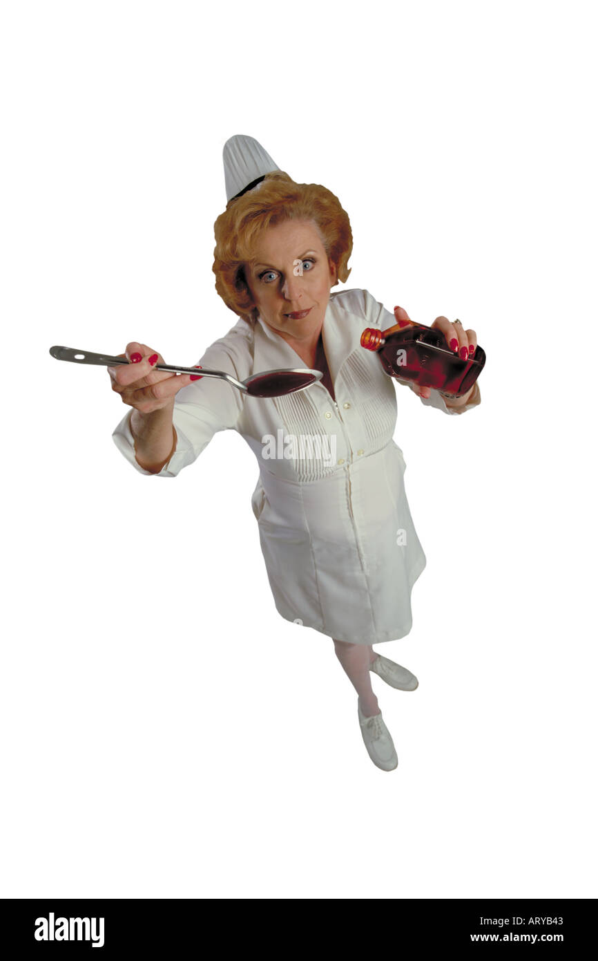 Humerous birdseye view of nurse holding up a spoon filled with medicine - Stock Image