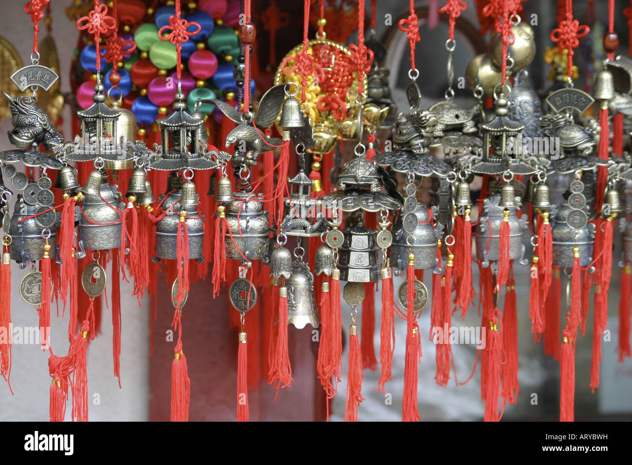 Colorful chinese ornaments adorn many storefront windows in Chinatown, downtown Honolulu, Oahu Stock Photo