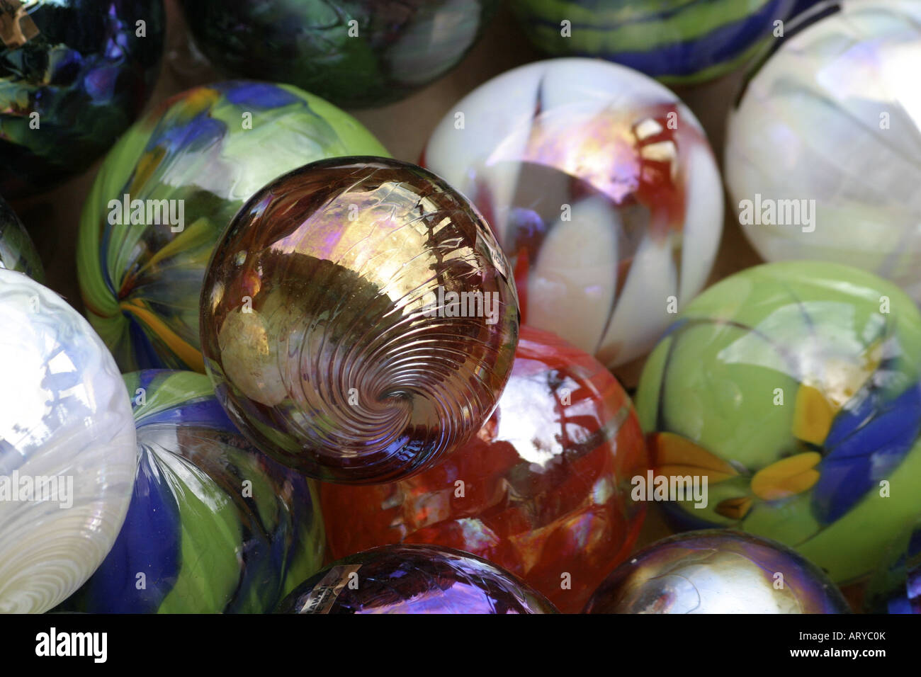 Colorful glass spheres represent the fine art of glassblowing at a studio in the town of Haleiwa on Oahu's north - Stock Image